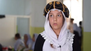 Rescued Ezidi girl smiles with hope after ISIS