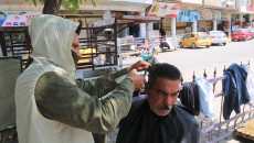 Meriwan's scissor cuts hair of laborers to grow their hopes