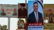 Daqua district dotted with pictures of political and military figures
