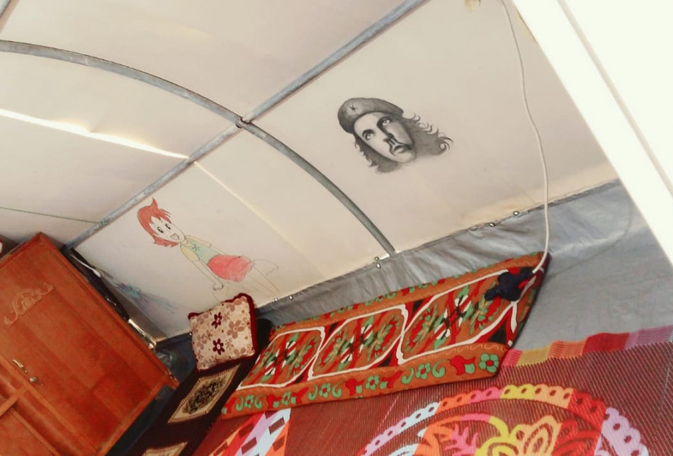 I initially cleaned the tents and later painted several pictures including a picture of Che Guevara