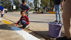 Telafer'in çocukları ve kadınları şehirlerini süslüyor ve sosyal uyum mesajını gönderiyorlar
