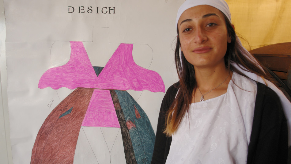 Narvin, a displaced 17 years old girl makes money from cloth designing in a camp