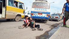 احمد وجميل صديقان يعملان كجابي في كراج لنقل الركاب بالموصل